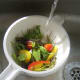 Mediterranean salad is washed in cold water