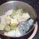 Butter and pepper added to potatoes and broccoli stalks for mashing