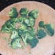Broccoli is carefully cut in to small florets