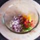 Main salsa ingredients added to a bowl