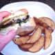 First bite taken from cheese stuffed mushroom burger