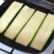 Starting to griddle strips of fresh zucchini
