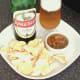 Curry and green chilli potted crayfish tails are served with mini poppadoms and Indian beer
