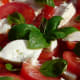 Fresh tomatoes layered with mozzarella and fresh basil leaves