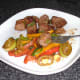 Enjoying spicy pork with leek and peppers