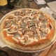 With all the toppings on the pie it is time to put it in the oven.