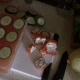 Lay out the cucumber slices where you want the appetizers to be.