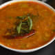 The raw tomato and onion sambar, ready to eat.