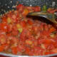 Saute the tomatoes with spices and other vegetables.