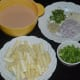 The batter and other ingredients for making baby corn Manchurian