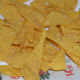 Step six: Fry the triangles in oil. When they are crispy, transfer them to an absorbent paper towel.