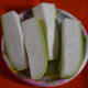 Remove the bottle gourd skin and cut the gourd in pieces for grating.
