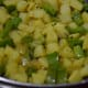Step one: Stir-fry the potato and capsicum in mustard seeds tempering.