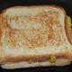 Step eight: Sprinkle some ghee or butter on the pan. Toast the sandwich till golden brown on both sides.