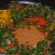 Step six: Add chole masala powder, red chili powder, turmeric powder, sugar, and salt.