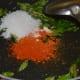 Step five: Add masala powders, hing powder, sugar, and salt to the pan.