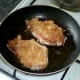 Pork steaks are gently shallow fried