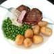Cutting in to griddled pork steak
