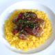 Freshly chopped mint garnishes pork vindaloo