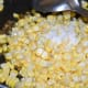 Step five: Add salt. Mix well. Stir-cook for 3-4 minutes. Now the sweet corn changes into a darker shade. Turn off the stove.