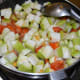Add the chopped bottle gourd. Throw in some salt and mix well. Stir-cook for 3–4 minutes.