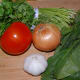 Prepare the rest of the ingredients for your dish. Mince the garlic, dice the onion, rough chop the tomato, spinach and cilantro.
