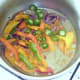 Peppers are added to softened onion and garlic