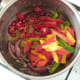 Peppers are added to sauteed onion