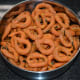 Step four: Make small rings out of them, as per instructions. Deep-fry them in batches of 8-10, in medium-high hot oil. Take them out when they become crispy. Place them on an absorbent paper. Repeat the same for making all the kodubale.