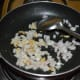 Step three: Add chopped onions. Continue sauteing till they become translucent.
