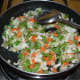 Cooking the mixed veggies.