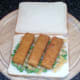 Fish fingers are laid on pea bed
