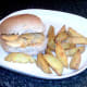 Double cheese and onion crisps sandwich and spicy wedges ready for service