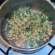 Drained peas are seasoned
