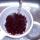 Kidney beans are washed under running cold water