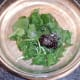 Redcurrant jelly and seasonings are added to salad leaves
