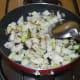 Step three: Add diced knol-khol. Add some salt. Stir-cook on a high heat for 5 to 6 minutes.