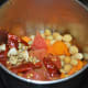 Step six: Combine cooked chickpeas, carrots, cooked tomatoes, and roasted spices in a mixer or blender.