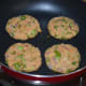 Step three: Take a lemon-sized portion of the mixture. Shape it like a patty. Make 4 such shapes. Shallow-fry them in a pan.
