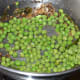 Step three: Throw in fresh peas. Add some salt. Saute for 3 minutes.