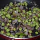 Add fresh or frozen peas. Add some salt. Stir-cook for 2-3 minutes.
