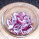 Sliced onion is added to sauce