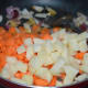 Step three: Throw in chopped potatoes and carrots. Add some salt. Stir-cook on a high-heat for three minutes.