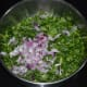 Step two: Add chopped fenugreek leaf and chopped onions to the batter. Mix well.