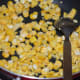Step five: Saute corn kernels in remaining butter for 2-3 minutes. Sprinkle a few drops of water if needed.