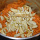 Step five: Add sauteed garlic. Grind or pulse till garlic gets crushed completely and blends with the other ingredients.