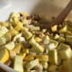 add yellow squash, onion and bread cubes to a medium size bowl and mix well