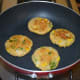 Step six: Cook them till the bottom side gets golden brown. Flip them.
