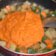Step seven: Add gravy sauce to the pan. Stir-cook for 2 minutes.