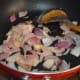 Step three: Saute onions in the same pan. Fry till they become transparent.